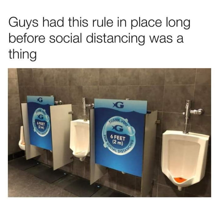 Guys social distancing in toilets