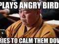 Monk playing Angry Birds