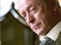 In Caine's classy voice
