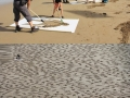Soldiers etched into sand