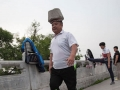 Chinese man has been walking with a 40kg rock on his head