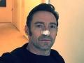 Hugh Jackman toasts after kicking cancer's a**